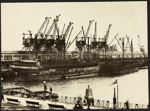 Photograph: Seven electric cranes working SS KAIAPOI at Princes Wharf, 1926.; Auckland Harbour Board. Engineer's Dept.; 2010.132.300