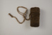 Covered needle case filled with grease; Fred West; 1989.46.12