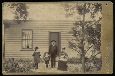 [John Wilds and family outside his home in North Street, Timaru]; Burford, A; 1896-1906; 2057