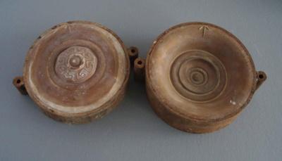 Ram press cases - escutchion plate; Crown Lynn Potteries Limited; 1978; 2009.1.1376.1-2