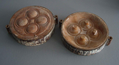 Ram press cases - door handles; Crown Lynn Potteries Limited; 1980-1989; 2009.1.1372.1-2