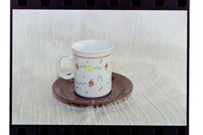 Negative - mug and saucer orange wavy-stripe and flowers; 19 Apr 1988; 2008.1.3736