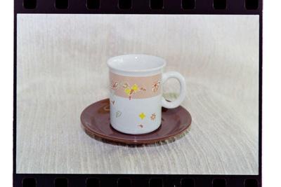 Negative - mug and saucer orange spot-stripe and flowers; 19 Apr 1988; 2008.1.3734