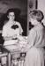B&W photograph of U/K HOF female staff member at the Ekka, Brisbane, 1992, serving female customer.; 1992; 16739