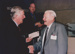 Photograph - Colin Munro hands an award to John Buckley at the Dame Mary Durack Outback Art and Craft Awards.  ; Exposure Photographers; 2003; 19219