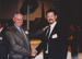 Photograph - Charlie Hassett and Dennis Gardner shake hands at the Dame Mary Durack Outback Art and Craft Awards.  ; Exposure Photographers; 2003; 19255