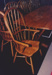 Photograph - A chair from Dave Putland's table and chair set at the Dame Mary Durack Outback Art and Craft Awards.  ; Exposure Photographers; 2003; 19244