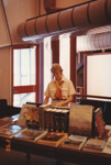 Photograph - Staff member looking over a presentation display at the Stockman's Hall of Fame. ; 1990; 17766