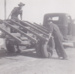 B&W Photograph - Two males (David & Buddy) removing old wooden(?) truck tray fom vehicle. ; c 1950; 18359