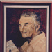 Photograph - Painting of smiling man holding a picture ; Exposure Photographers; 2003; 19182