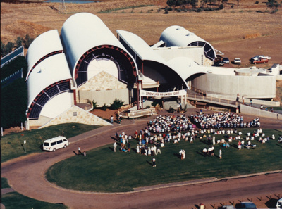 Colour aerial photograph of ASHOF Building at 1990 Drovers Reunion, with assembled crowd generally seated in front of building.  ; 1990