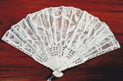 White, lace-like, folding hand fan. ; 1995; 19889