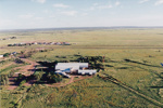 Colour aerial photographs of ASHOF Building, Longreach from the South and South East.  Longreach Airport in background.  ; c 1990; 16589