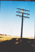 Telegraph lines and several poles, with numerous wires, probably at ASHOF.;  ; 20522