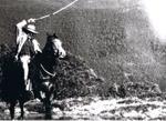 Photograph - Man on horseback cracking a whip. ; 9156