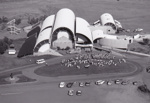 B&W aerial photograph of ASHOF Building at 1990 Drovers Reunion, with assembled crowd generally seated in front of building.  ; 1990; 16580