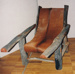 Photograph: Bush timber and leather squatter's chair. ; 1995; 19388