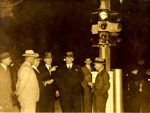 Switching on of Brisbane's first traffic lights at the corner of Ann and Albert Streets; 1937; PM2939c