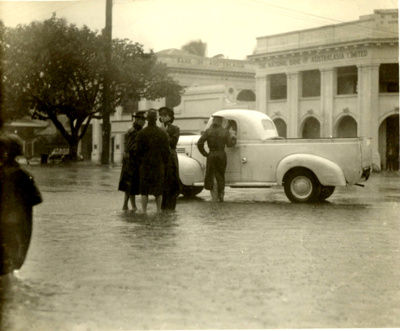 Police officers conducts traffic control during Cairns flood; 1949; PM1249