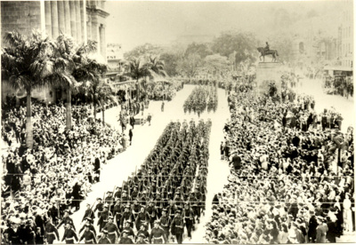 Seventh Division of the Second AIF marching past Brisbane City Hall; 1944; PM2134