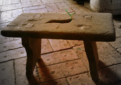 Stool, used for milking, wood, rectangular seat, 2 legged, made by farming family