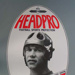 Football (Australian football, rugby league, rugby union) headwear advertising poster; Unknown; Unknown; 2006.5510