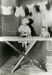 Photograph, Ruth Hall, young girl ironing doll clothes; circa 1923; M84.33.24