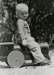 Photograph, Toddler Greg Smith on toy locomotive; 1947; M84.33.22