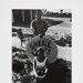 [Alice Wells and Steve in front of Shell sign]; Fichter, Robert; ca. 1967; 1972:0256:0001