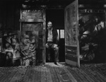 Untitled [Man standing in the doorway of a studio]; Colwell, Larry; ca. 1950s; 1972:0115:0001
