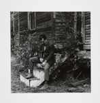 [Man sitting on wooden front steps of a wooden house]; Fichter, Robert; ca. 1967; 1983:0060:0001