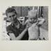 Untitled [Woman holding up baby.]; Brosan, Robert; 1968; 2000:0114: 0001