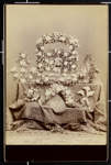 [Shrine with flowers with portrait of woman on a table with tapestry]; Curtiss and Smith; 1977:0036:0111