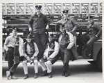 [Untitled, Seven firemen sitting on their firetruck]. ; Harris, Pamela; c.a. 1975; 1977:0101:9999