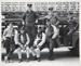 [Untitled, Seven firemen sitting on their firetruck]. ; Harris, Pamela; c.a. 1975; 1977:0101:9999