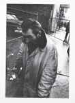 Untitled, [man with a cigarette, next to a chain link fence]. ; McLoughlin, Mike; c. a. 1970s; 1974:0023:0002
