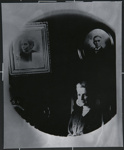 [Untitled, seated woman with portraits hung in the background]; Wells, Alice; c.a. 1960; 1988:0026:0005