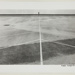 [Figure Stands in a Parking Lot in front of the Sea]; Kuligowski, Eddie; 1973; 1986:0014:0023