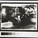 [Untitled, woman playing piano in tropical themed room]; Wells, Alice; ca. 1970; 1988:0026:0003