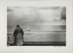 [Woman in Fur Coat Stands Facing the Beach]; Kuligowski, Eddie; 1973; 1986:0014:0007