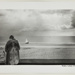 [Woman in Fur Coat Stands Facing the Beach]; Kuligowski, Eddie; 1973; 1986:0014:0007