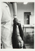 [Untitled, little boy hanging onto the hand of a nursery worker]. ; Heron, Reginald; 1966; 1972:0157:9999