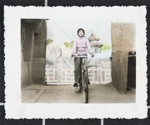 Portrait with bicycle and pavilion backdrop; Beijing Guangming Backdrop Studio; ca. 1985; 2009:0054:0001