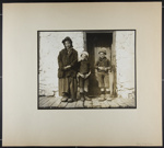 [woman and two boys standing before stone wall with door]; Hahn, Alta Ruth; ca.1930; 1982:0020:0025