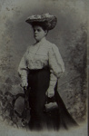 Untitled [Studio portrait of a woman wearing an elaborate hat and holding a small purse.]; Karl Riss; 1905; 1981:0053:0101