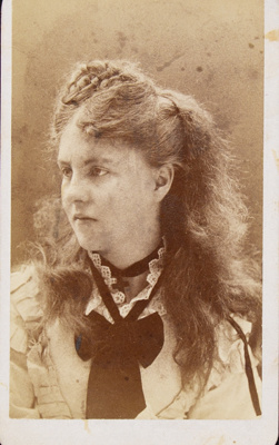 [Studio portrait of a young woman with an elaborately plaited hairstyle.]; J. H. Kent; ca. 18860; 1975:0031:0440