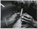 Untitled, [Man lighting a cigarette].; McLoughlin, Mike; c. a. 1970; 1974:0023:0004