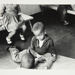 [Untitled, two boys play on floor of nursery, and a little girl and boy sit on benches]. ; Heron, Reginald; 1966; 1972:0161:9999