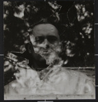 Untitled [Portrait of Ralph Eugene Meatyard through broken glass.]; Ritchie, Cranston; ca. 1960