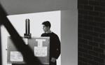 Untitled [Man and corkboard]; Mertin, Roger; ca. early 1960s; 1998:0005:0047